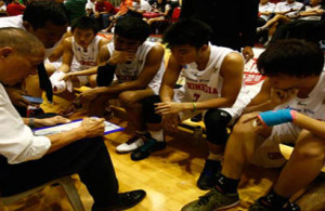 Nathaniel 'Nath' Canson (left), the head coach of Indonesia National Youth Team, is delivering the strategy to the players. He is recently awarded as the Coach of the Year of the premiere basketball league in Indonesia, Flexi National Basketball League (NBL) Indonesia 2011-2012.